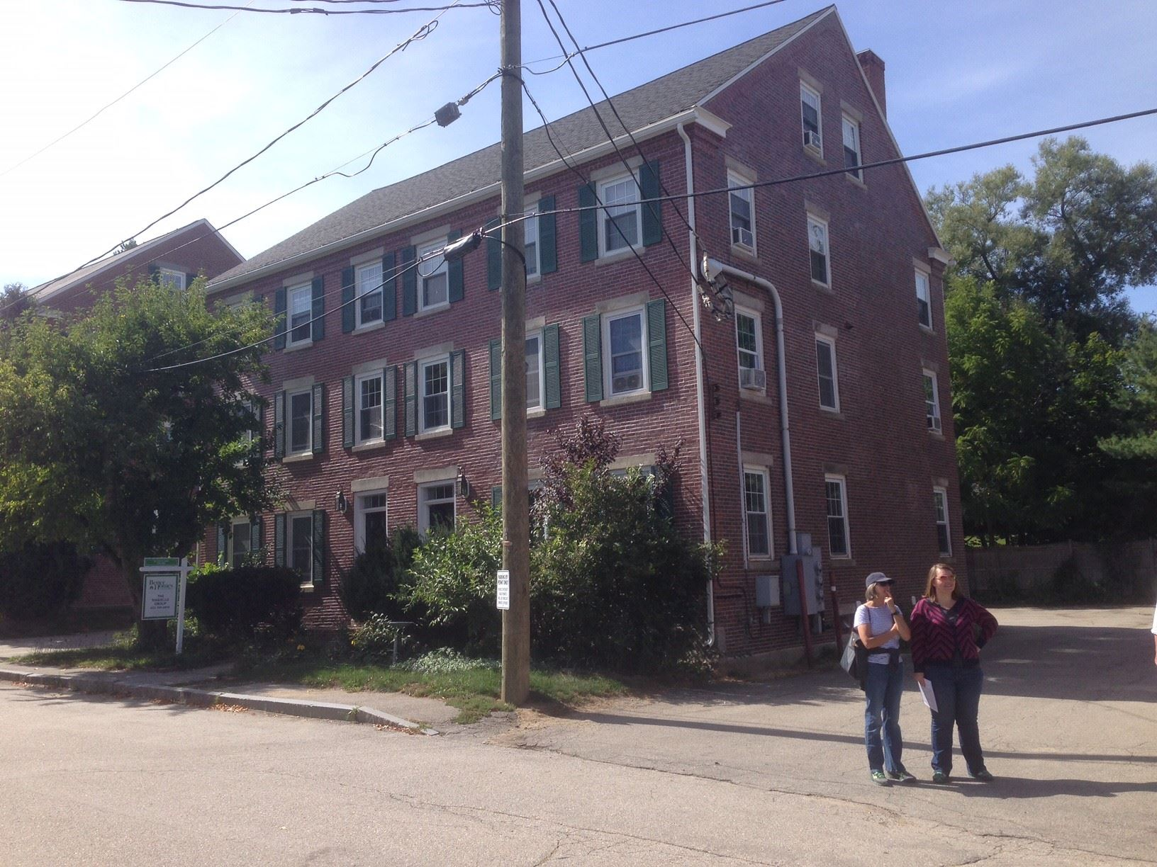 Members of the New England Chapter of the VAF examine worker housing in a textile mill village.
