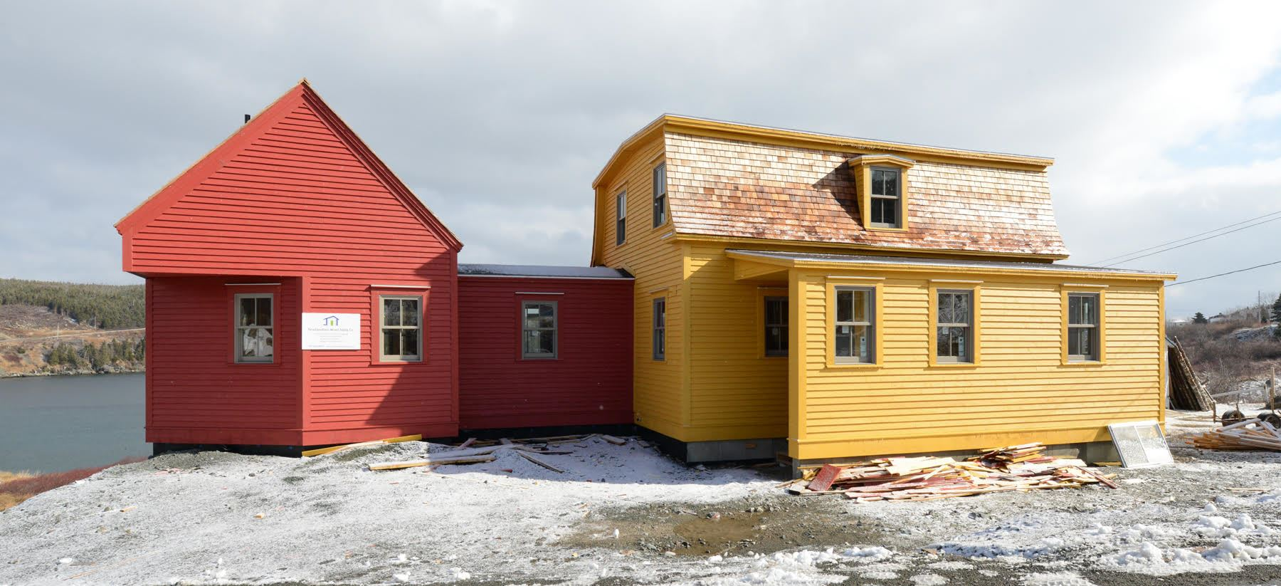 Restoration of the Keough Homestead in Calvert, Newfoundland a new addition for a studiobedroom was added to the east side of the house, painted with the red ochre colour typically used for outbuildings. Photo courtesy of Robert Mellin