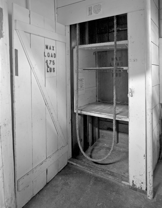 The dumb waiter at the second floor laundry and storerooms is functional and used regularly to supply the kitchen and housekeeping above.