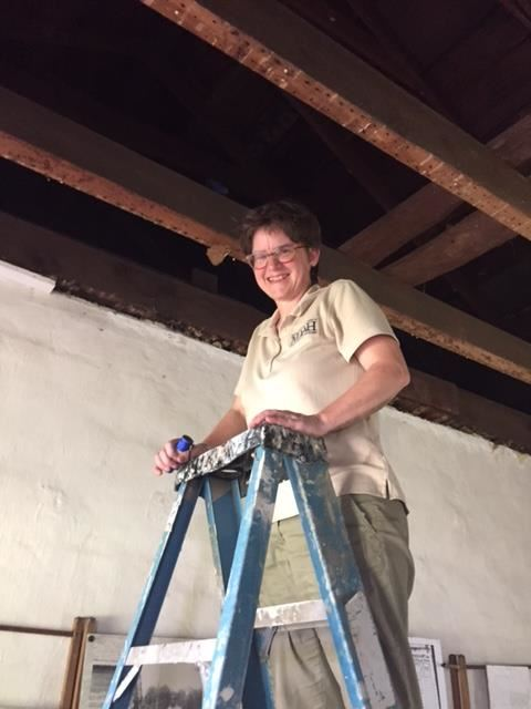 Using her vernacularist skills, Jennifer surveys outbuildings near Natchez. Photo courtesy of Jennifer Baughn.